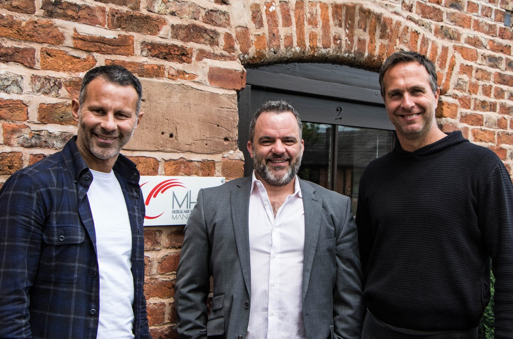 Ryan Giggs, Craig Henton and Michael Vaughan stood outside the hair transplant clinic in Manchester.