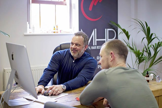 Rickitt having a consultation with Craig Henton inside the Manchester hair transplant clinic